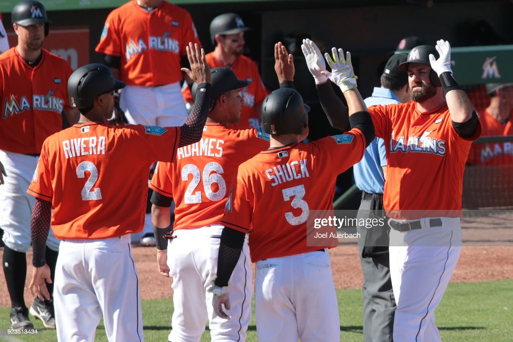 Scott Van Slyke #5 of the Miami Marlins is congratulated by teammates after hitting a grand slam home run against the St Louis Cardinals during the seventh inning of a spring training game at Roger Dean Chevrolet Stadium on February 23, 2018 in Jupiter, Florida. The Marlins defeated the Cardinals 6-4.