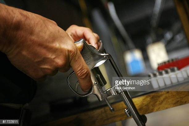 Scott Varner of Grapevine TX loads a 38 caliber Smith Wesson hand gun June 26th at the DFW Gun Range and Training Center in Dallas Texas The US...