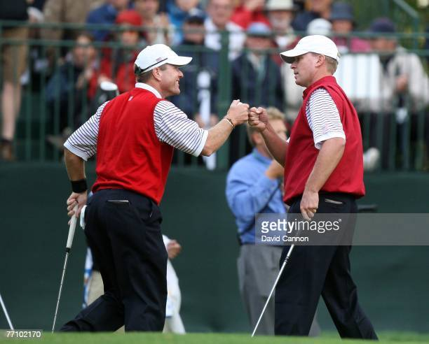 Scott Verplank and Steve Stricker of the U.S.Team celebrate a Verplank birdie on the 16th hole during the round 2 four ball matches at the Presidents...
