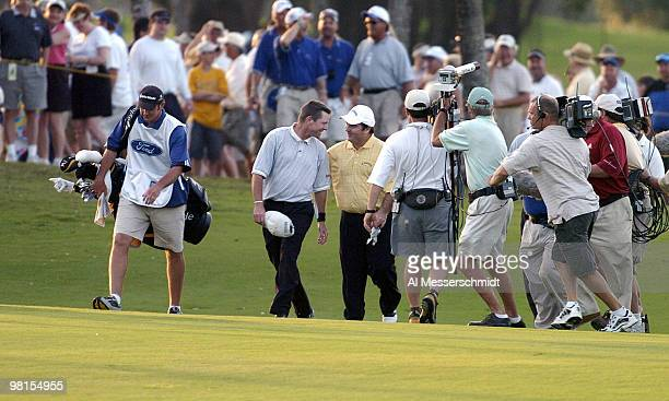 Scott Verplank congratulates Craig Parry of Australia after an eagle shot for a win on the 18th fariway in the final round of the PGA Tour Ford...