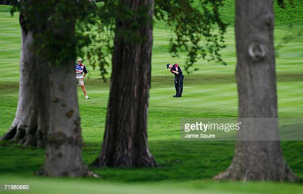 Scott Verplank of USA hits his third shot on the 4th hole during his singles match against Padraig Harrington of Europe on the final day of the 2006...