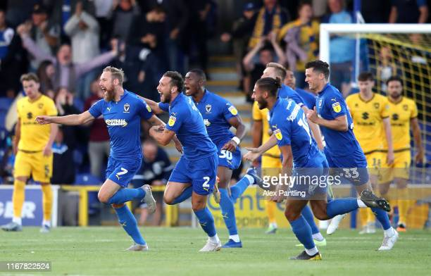Scott Wagstaff of AFC Wimbledon celebrates after scoring his sides first goal during the Carabao Cup First Round match between AFC Wimbledon and MK...