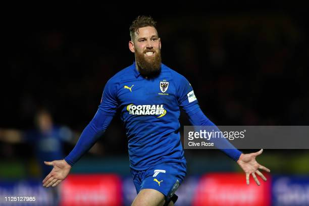 Scott Wagstaff of AFC Wimbledon celebrates after scoring his team's second goal during the FA Cup Fourth Round match between AFC Wimbledon and West...