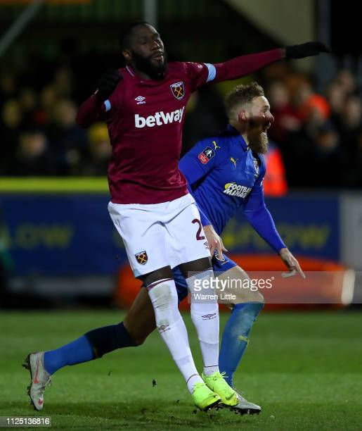 Scott Wagstaff of AFC Wimbledon celebrates past Arthur Masuaku of West Ham United after scoring his team's third goal during the FA Cup Fourth Round...
