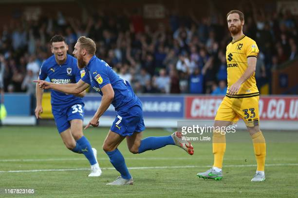 Scott Wagstaff of AFC Wimbledon celebrates scoring a goal during the Carabao Cup First Round match between AFC Wimbledon and Milton Keynes at The...
