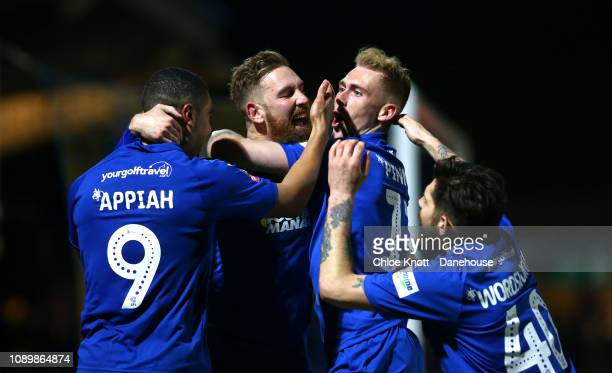 Scott Wagstaff of AFC Wimbledon celebrates scoring his teams third goal during the FA Cup 4th round match between AFC Wimbledon and West Ham United...