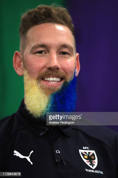 Scott Wagstaff of AFC Wimbledon has his beard dyed yellow and blue during an AFC Wimbledon Media access event ahead of their FA Cup fifth round match...