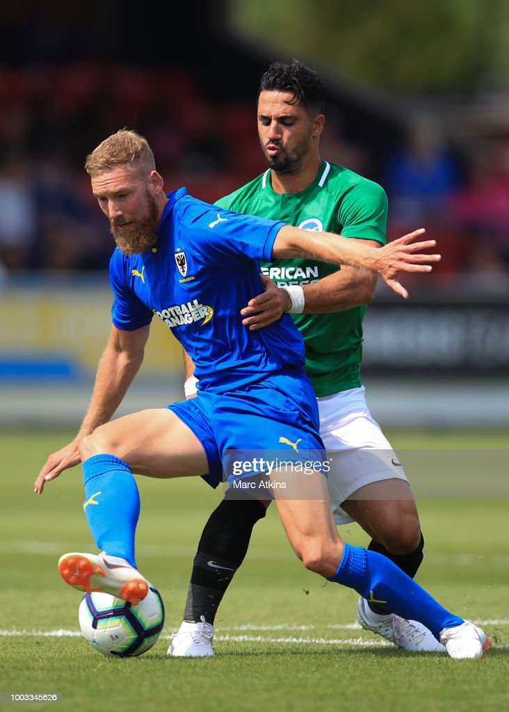 Scott Wagstaff of AFC Wimbledon in action with Beram Kayal of Brighton and Hove Albion during the pre season friendly match between AFC Wimbledon and Brighton and Hove Albion at The Cherry Red Records Stadium on July 21, 2018 in Kingston upon Thames, England.