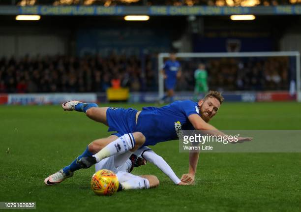 Scott Wagstaff of AFC Wimbledon is tackled by Matthew Done of Rochdale during the Sky Bet League One match between AFC Wimbledon and Rochdale at The...