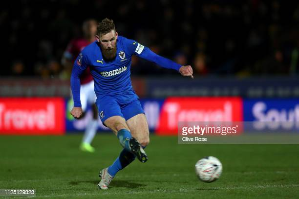 Scott Wagstaff of AFC Wimbledon scores his team's second goal during the FA Cup Fourth Round match between AFC Wimbledon and West Ham United at The...