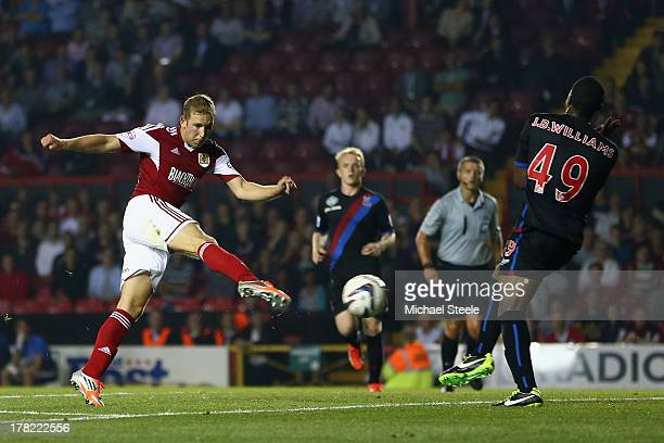 Scott Wagstaff of Bristol City fires his sides second goal past Jerome BinnomWilliams of Crystal Palace during the Capital One Cup second round match...