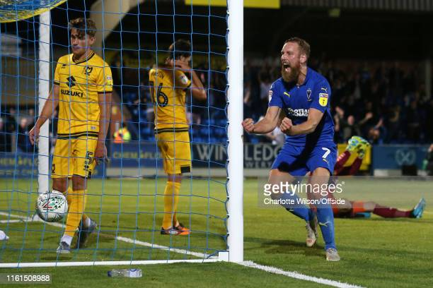 Scott Wagstaff of Wimbledon celebrates their last minute equaliser during the Carabao Cup First Round match between AFC Wimbledon and Milton Keynes...