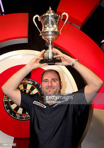 Scott Waites of England celebrates with the trophy after defeating Tony O'Shea of England in the final of the BDO Lakeside World Professional Darts...