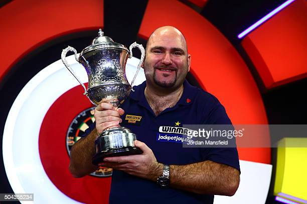 Scott Waites of England celebrates with the trophy after winning the Men's final match against Jeff Smith of Canada during Day Nine of the BDO...