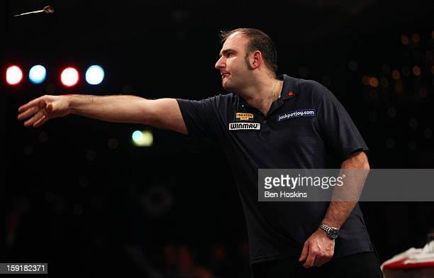 Scott Waites of England in action during his second round match against Geert de Vos of Belgium on day five the BDO Lakeside World Professional Darts...