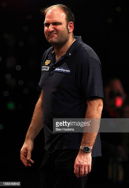 Scott Waites of England reacts during his semi final match against Richie George of England on day eight of the BDO Lakeside World Professional Darts...