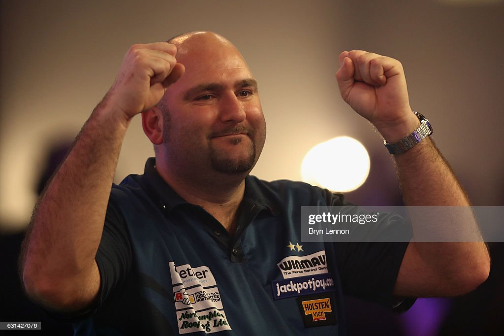 Scott Waites of Great Britain celebrates winning his first round match on day four of the BDO Lakeside World Professional Darts Championships on January 10, 2017 in Frimley, England.