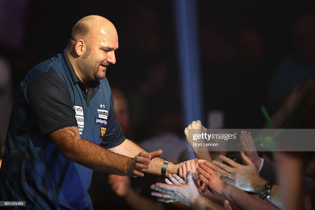 Scott Waites of Great Britain walks on for his first round match on day four of the BDO Lakeside World Professional Darts Championships on January 10, 2017 in Frimley, England.