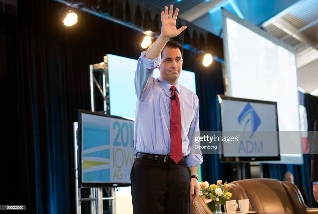 Scott Walker, governor of Wisconsin, waves to the crowd during the Iowa Ag Summit at the Iowa State Fairgrounds in Des Moines, Iowa, U.S., on Saturday, March 7, 2015. The event aims to highlight the role that agriculture plays in Iowa and the rest of the world. Photographer: Daniel Acker/Bloomberg via Getty Images