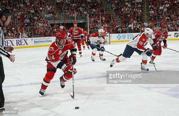 Scott Walker of the Carolina Hurricanes caries the puck during their NHL game against the Florida Panthers on April 4 2008 at RBC Center in Raleigh...