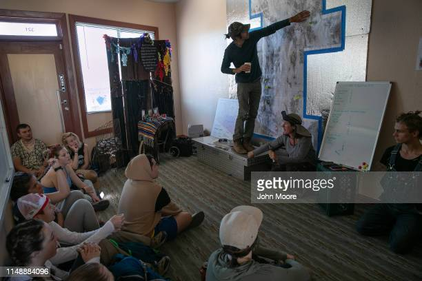 Scott Warren a volunteer for the humanitarian aid group No More Deaths meets with college student volunteers on May 11 2019 in Ajo Arizona Warren is...