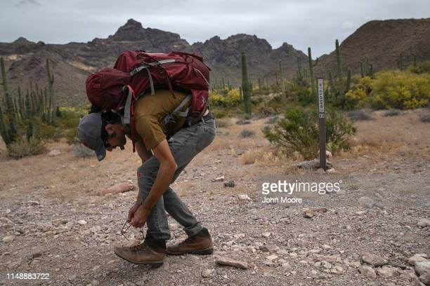 Scott Warren a volunteer for the humanitarian aid organization No More Deaths walks into the Organ Pipe Cactus National Monument to lead a group of...
