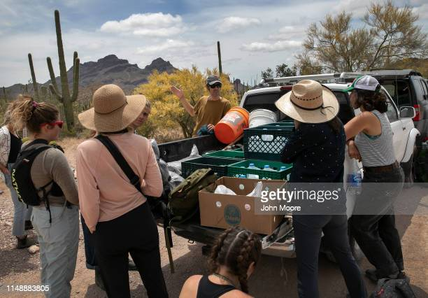Scott Warren a volunteer for the humanitarian aid organization No More Deaths leads a group of student volunteers delivering food and water along...