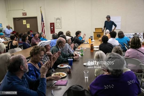Scott Warren a volunteer for the humanitarian aid organization No More Deaths speaks with local residents during a community meeting to discuss...