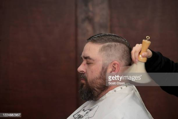 Scott Watson gets a haircut at Gatsby's Barber Shoppe and Shave Parlor on May 13, 2020 in Chesterton, Indiana. Recently, Indiana began allowing some...