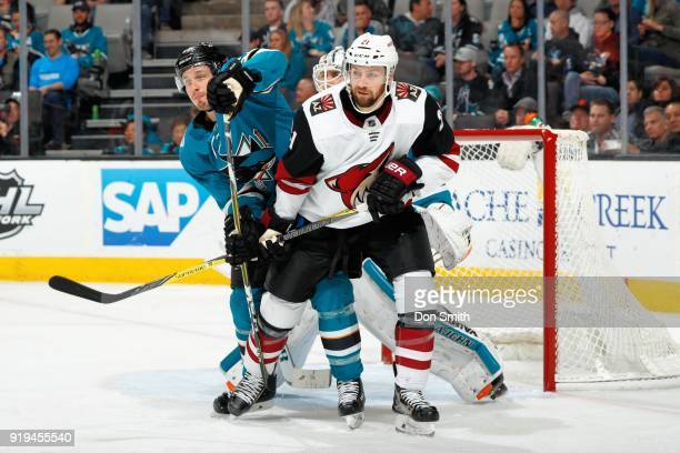 Scott Wedgewood and Derek Stepan of the Arizona Coyotes defend Justin Braun of the San Jose Sharks at SAP Center on February 13 2018 in San Jose...