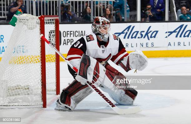 Scott Wedgewood of the Arizona Coyotes defends the net against the San Jose Sharks at SAP Center on February 13 2018 in San Jose California