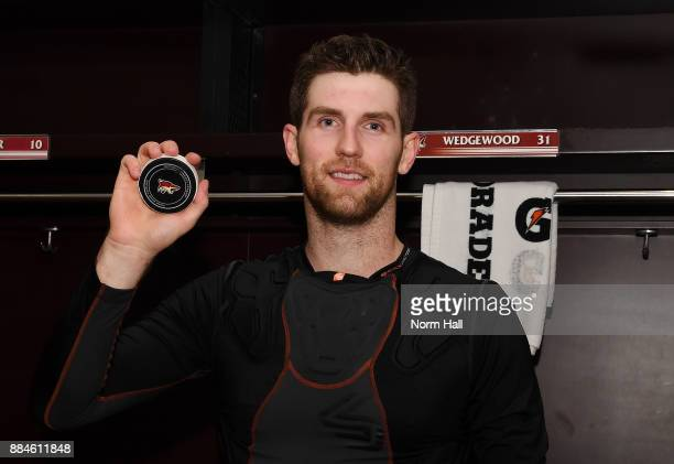 Scott Wedgewood of the Arizona Coyotes holds up a game puck after getting a 50 shutout win against the New Jersey Devils at Gila River Arena on...