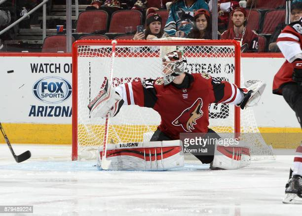 Scott Wedgewood of the Arizona Coyotes makes a blocker save against the San Jose Sharks at Gila River Arena on November 22 2017 in Glendale Arizona
