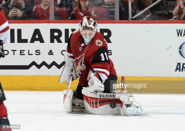 Scott Wedgewood of the Arizona Coyotes makes a pad save against the San Jose Sharks at Gila River Arena on November 22 2017 in Glendale Arizona