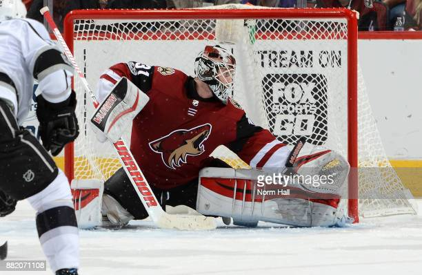 Scott Wedgewood of the Arizona Coyotes makes a pad save against the Los Angeles Kings at Gila River Arena on November 24 2017 in Glendale Arizona