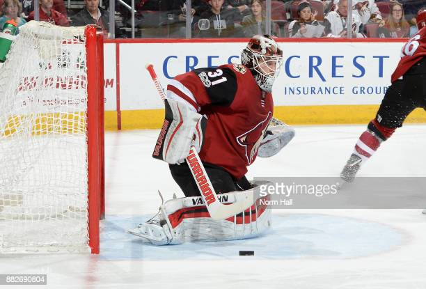 Scott Wedgewood of the Arizona Coyotes makes a pad save against the Vegas Golden Knights at Gila River Arena on November 25 2017 in Glendale Arizona