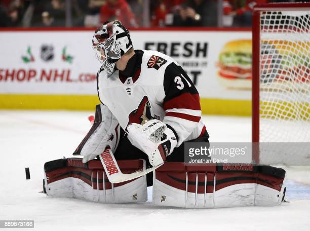 Scott Wedgewood of the Arizona Coyotes makes a save against the Chicago Blackhawks at the United Center on December 10 2017 in Chicago Illinois