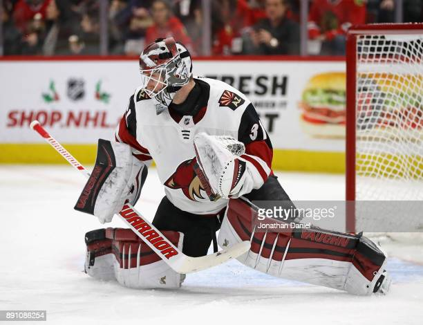 Scott Wedgewood of the Arizona Coyotes makes a save off of his leg pad against the Chicago Blackhawks at the United Center on December 10 2017 in...