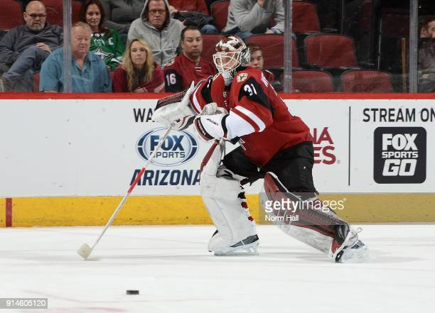 Scott Wedgewood of the Arizona Coyotes skates after the puck against the Dallas Stars at Gila River Arena on February 1 2018 in Glendale Arizona