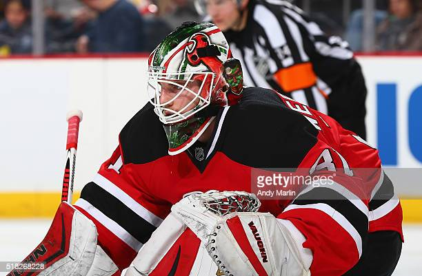 Scott Wedgewood of the New Jersey Devils defends his against the Washington Capitals during the game at the Prudential Center on March 25 2016 in...