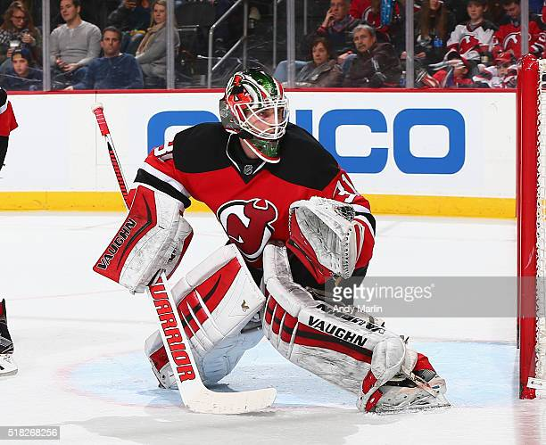 Scott Wedgewood of the New Jersey Devils defends his net against the Washington Capitals during the game at the Prudential Center on March 25 2016 in...