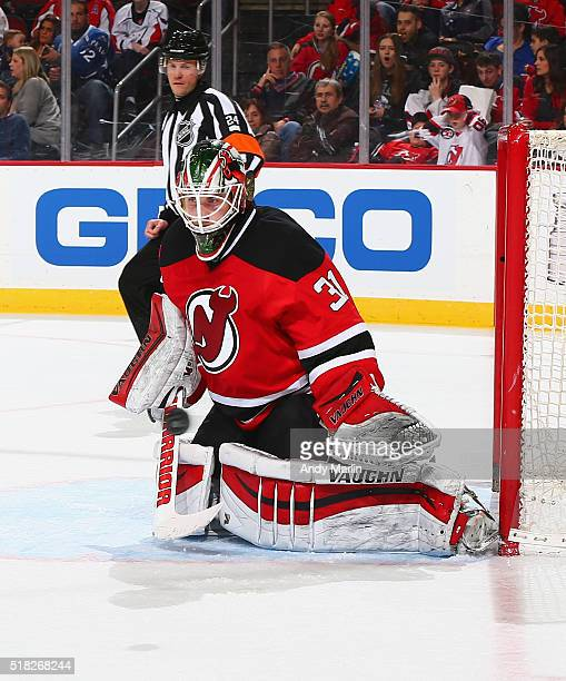 Scott Wedgewood of the New Jersey Devils defends the net against the Washington Capitals during the game at the Prudential Center on March 25 2016 in...
