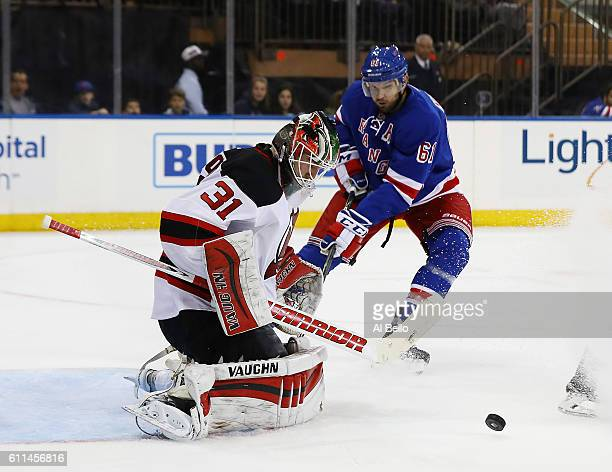 Scott Wedgewood of the New Jersey Devils makes a save against the New York Rangers during their pre season game at Madison Square Garden on September...