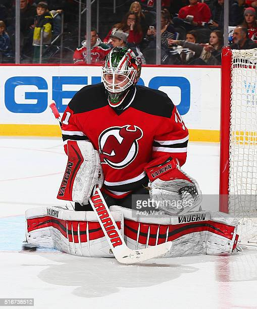 Scott Wedgewood of the New Jersey Devils playing in his first NHL game makes a pad save against the Columbus Blue Jackets during the game at the...