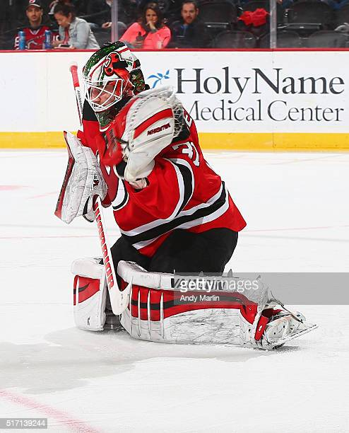 Scott Wedgewood of the New Jersey Devils playing in his first NHL game makes a glove save against the Columbus Blue Jackets during the game at the...