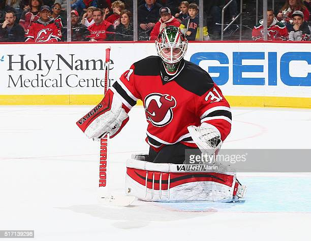 Scott Wedgewood of the New Jersey Devils playing in his first NHL game defends his net against the Columbus Blue Jackets during the game at the...