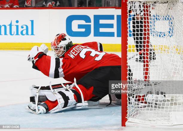 Scott Wedgewood of the New Jersey Devils skates against the Washington Capitals during a preseason game at the Prudential Center on September 18 2017...