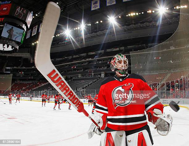 Scott Wedgewood of the New Jersey Devils skates in warmups prior to the game against the New York Islanders at the Prudential Center on October 5...