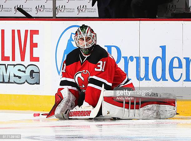Scott Wedgewood of the New Jersey Devils stretches during pregame warmups prior to playing in his first NHL game against the Columbus Blue Jackets at...