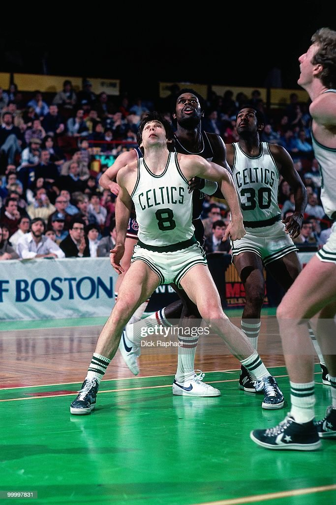 Scott Wedman #8 of the Boston Celtics boxes out during a game played in 1983 at the Boston Garden in Boston, Massachusetts.